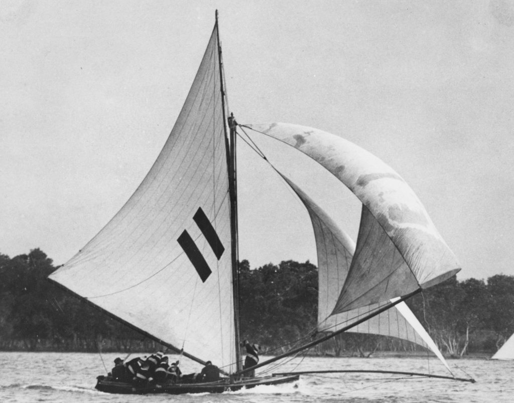 Tangalooma, an 18 footer, on it's way down the Brisbane River to win the Australian Championship. Source: State Library of Qld https://hdl.handle.net/10462/deriv/149647