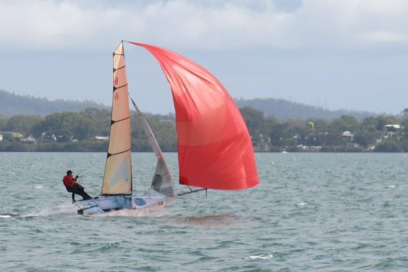 12ft skiff with red spinnaker